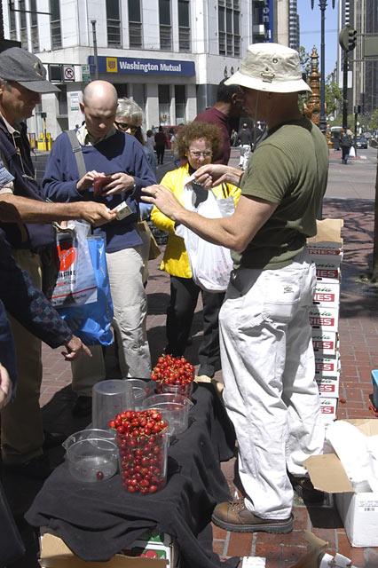 Selling Cherries on Market St. © Dennis Mojado